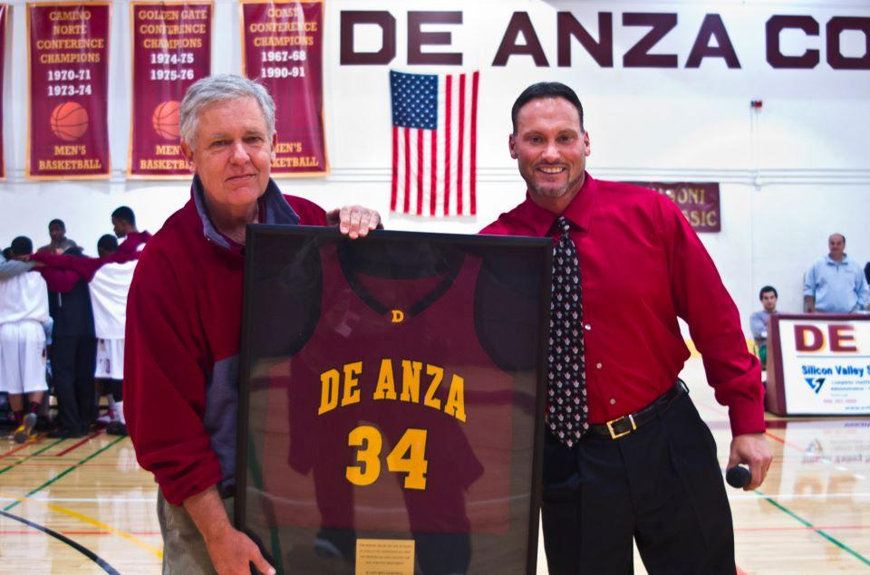 Commemoration - Jason Damjanovic, right, and the men's basketball team present Tom Giebler, left, with a framed jersey to honor his 34 years of service.