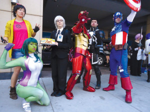 The Avengers Save The Day Marvel superheros help a man in a suit sell waffles.