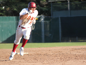 <p><b>Next Base</p></b> Rey Gallegos clears second base and makes a run for third base during one of their regular season games.