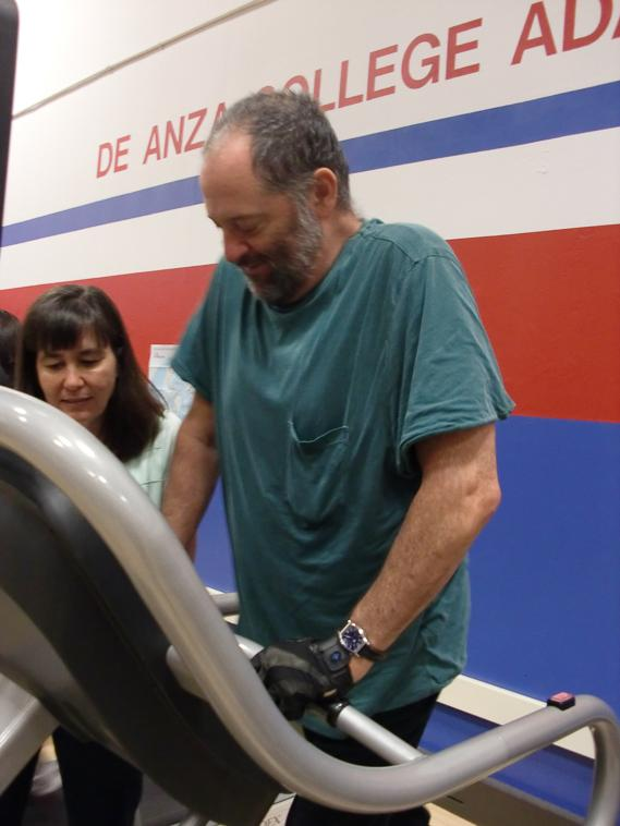 Slowly Treading Adapted program participant John Shatz works on the treadmill with instructor Mary Bennet