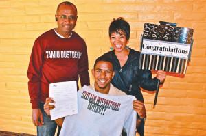 New Dustdevil Denzel Copeland, 19, business administration, celebrates with his parents, hoisting his Texas A&M International sweatshirt.