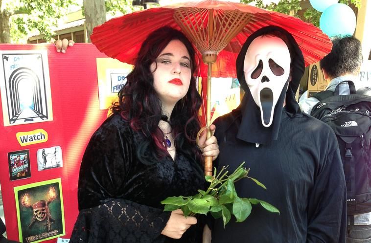 American Gothic Jenna Carrender dressed up as Morticia Addams and fellow De Anza Film Society member Tony MacIntire, 20, film major, as Scream.