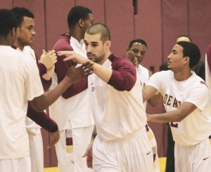International Star Basketball player Stefan Demirovic, 22, business administration, high fives his De Anza teammates before starting a game on Feb. 20.