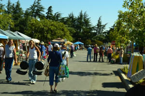 Shoppers walk along rows of vendors on Oct. 5, 2015 at the De Anza Flea Market. The market has since transitioned online.