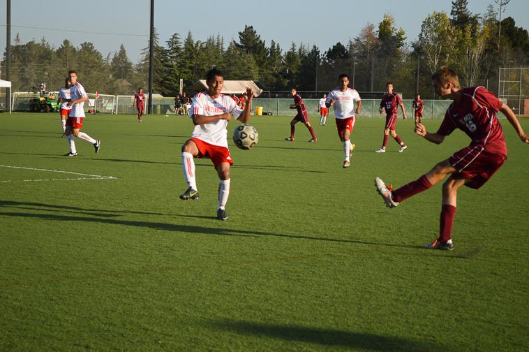 Sophomore midfielder Zack Williams (16) blasts the ball into CCSF Rams territory.