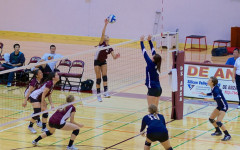Sophomore Julie Sam (2) takes a great leap to spike the ball into the opponent's court