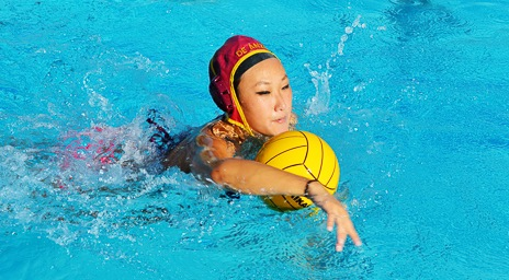 Sophomore Jane Kim power swims to dribble the ball towards the opposing net during practice Wednesday Nov. 6.