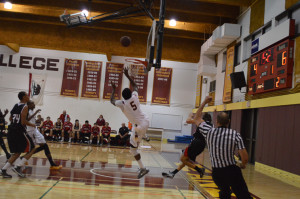 Sophomore Shaquille Gilbert (5) takes a shot after breaking away from a Foothill player Friday,Nov.13.