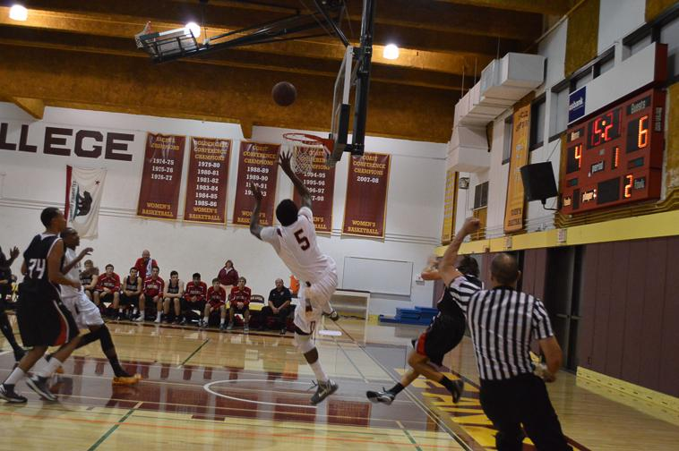 Sophomore+Shaquille+Gilbert+%285%29+takes+a+shot+after+breaking+away+from+a+Foothill+player+Friday%2CNov.13.