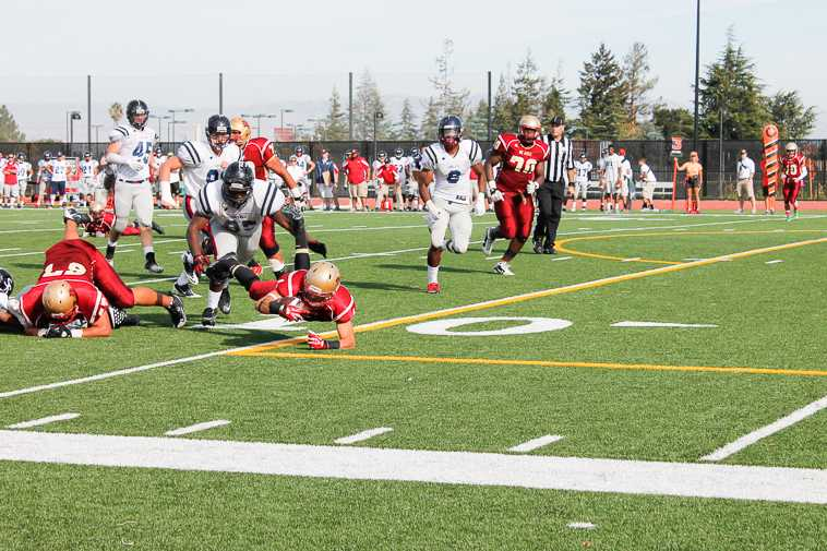 A De Anza college football player takes a dive for a first down against Santa Rosa Saturday Nov. 2 at De Anza.