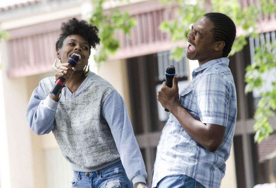 Lyneisha Smith, 20,  and Jairus Richard, 19,  show their passion for music during De Anza's Club Karaoke day in the main quad, Thursday April 17.