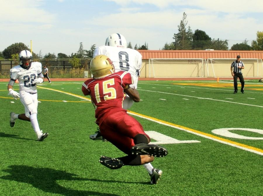 A pass intended for De Anza sophomore wide receiver James Roe (15) is intercepted by American River defensive back Malcolm Scott (8). The Dons lost their home opener 49-28 on Saturday Sept. 13.