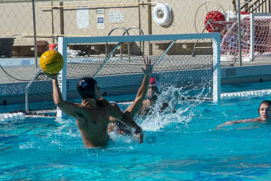 Driver Robert Raya (12) makes a last second throw during a close game with the Merced Devils.