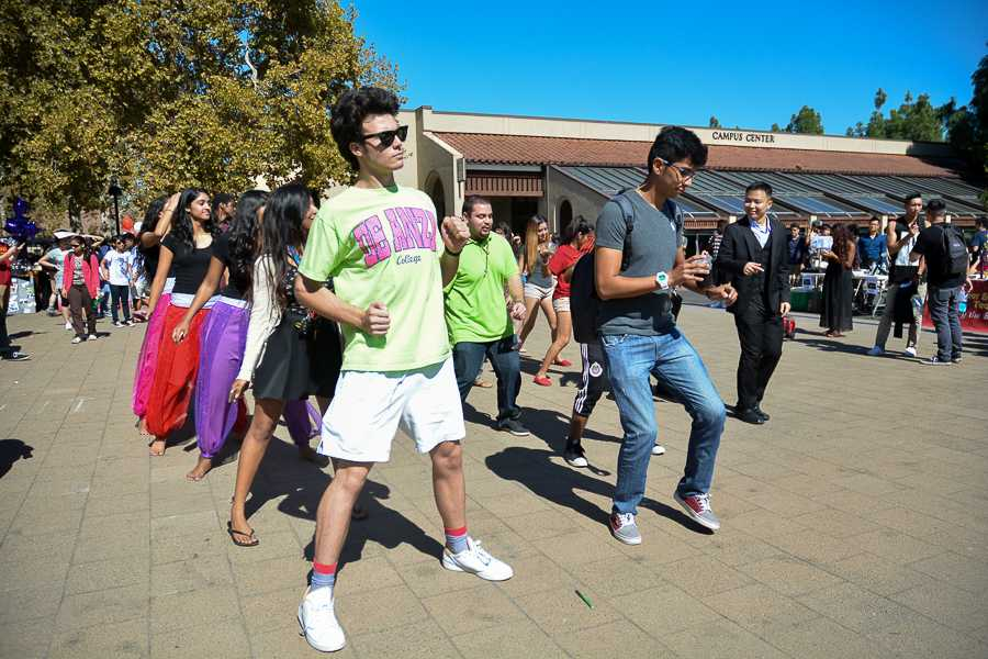 Students from different clubs join together during an impromptu dance in the main quad during club day on Thursday Oct. 9.