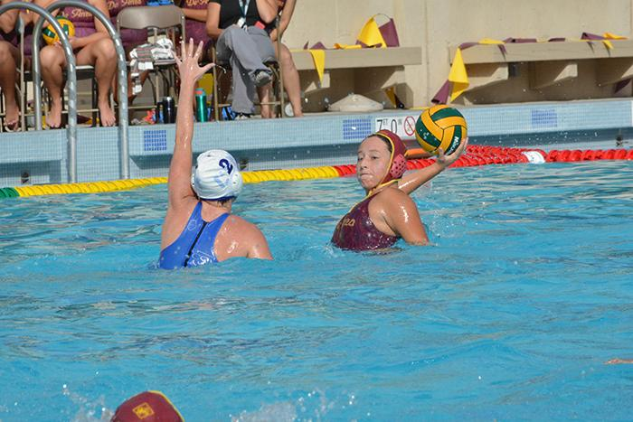 Dons' attacker Stephanie Bonilla passes the ball to a teammate as a San Mateo player defends. De Anza College lost the match 19-5 to San Mateo College on Wednesday Oct. 15. Their record on the season is 2-9 overall and 1-4 in conference play.