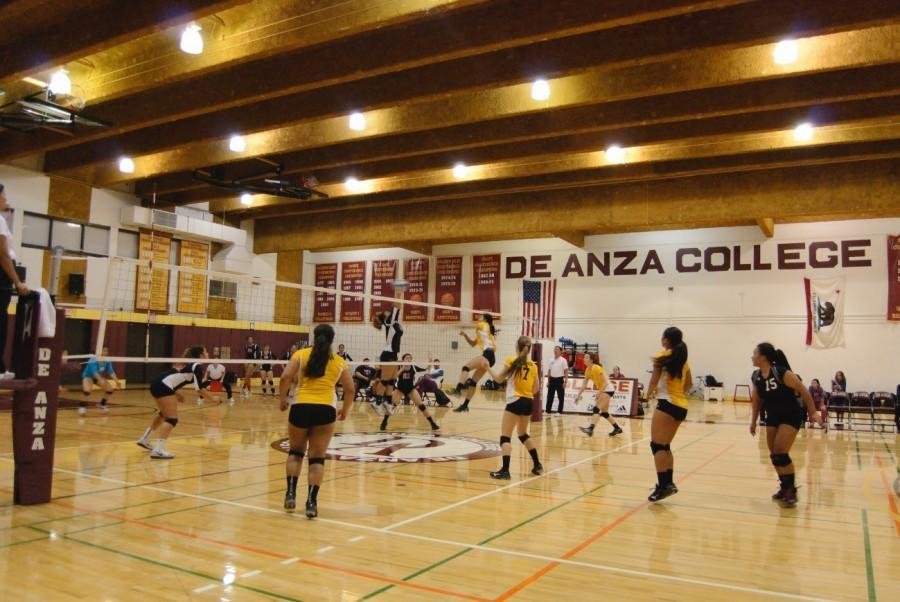 De Anza freshman middle blocker Xena Thach spikes the ball over a C.C.S.F. defender. The Dons lost the match 3 sets to 2 after winning the first two sets of the game on Friday Oct. 17.