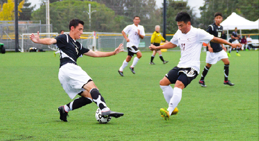 De Anza freshman defender Sean McLoughlin (21) protects the ball from an oncoming Monterey