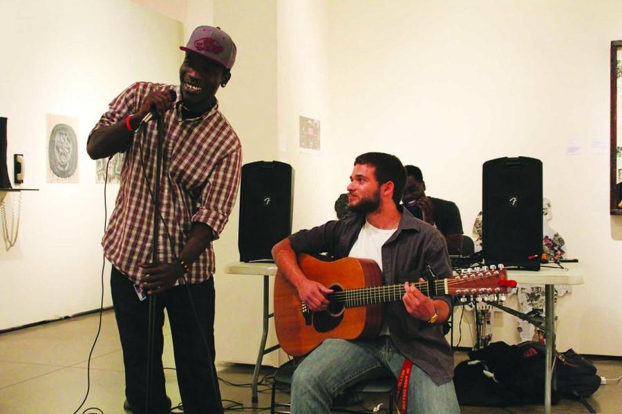 Two performers, a guitarist and a singer, take the stage at Open Mic Night on Thursday, Nov.6 in the Euphrat Museum.