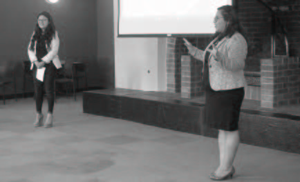 Sisters Maily Ramos (left) and Shania Ramos (right) lead a workshop at the DREAM Summit event May 15 at De Anza College.