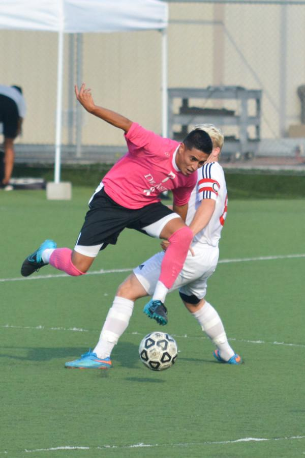 Forward Miguel Castillo (7) battles for possession against a Foothill College defender in their 1-1 draw on Tuesday Oct. 13.