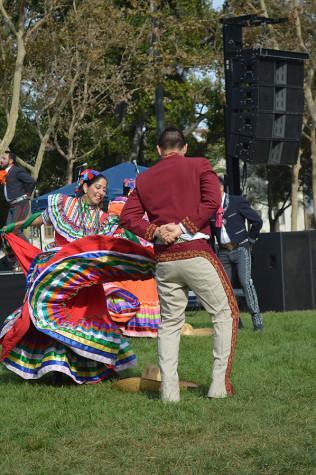 Los Lupenos repforms Mexican folk dancing during Dia de los Muertos celebration at St. James Park on Oct.22