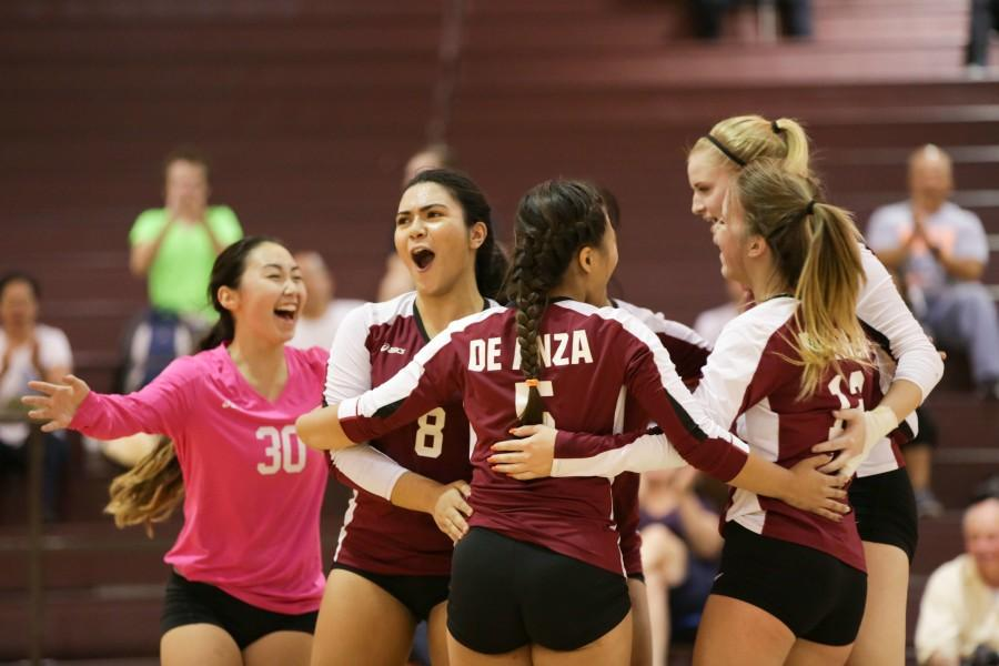 The De Anza woman's volleyball's team celebrates a victorious five-match win (23-25, 25-16, 25-14, 25-27, 15-12) over San Jose city College, snapping their 12-game losing streak on Wednesday Oct. 21.