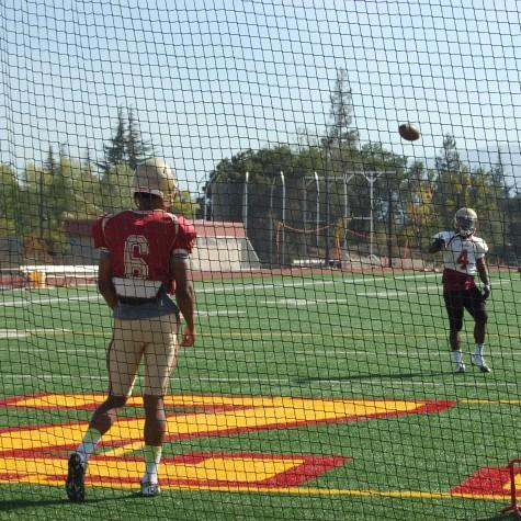 De Anza Quarterback Ron Johnson loosens his arm before practice. Johnson threw for 254 yards, four touchdowns and one interception against Laney on Saturday Oct. 3.