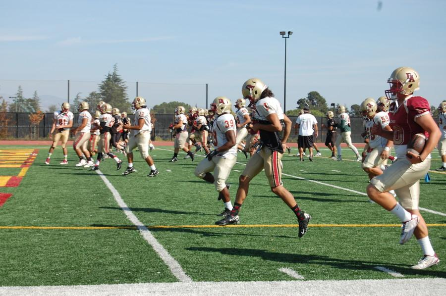 The Dons run warmup drills during practice. The Dons' fierce defense forced four turnovers in their 24-14 win over Laney.