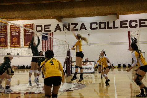 De Anza Middle blocker Anna Craig (1) spikes the ball during the Dons' match against Ohlone College on Friday Oct. 3.