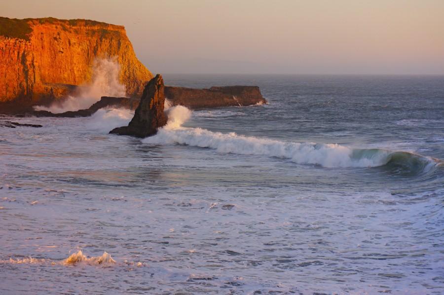 Waves splashing over cliffs at Davenport Beach