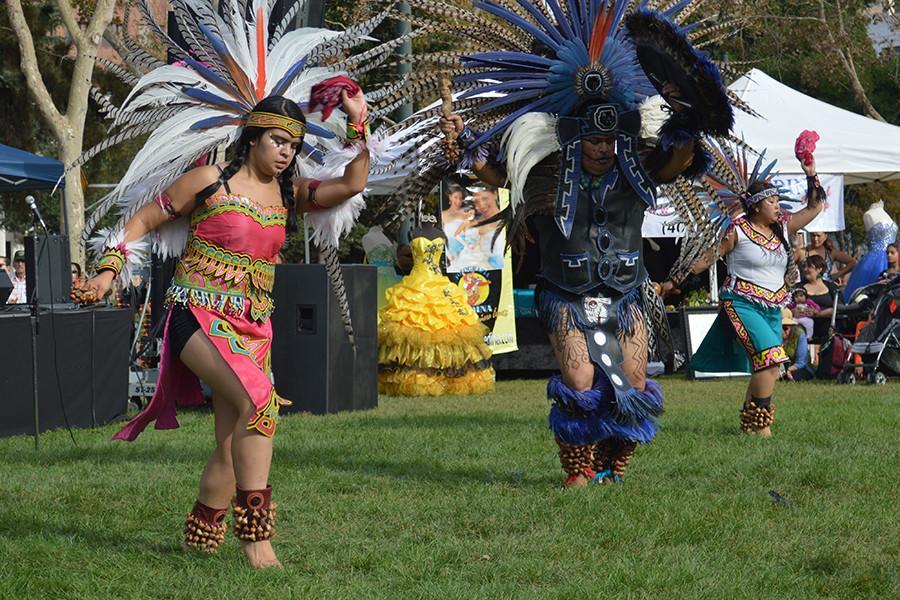 Calpuli Yaocuauhti dancers perform a traditional Aztec dance during Dia de los Muertos celebration at St. Jmnes Park on Oct. 22.