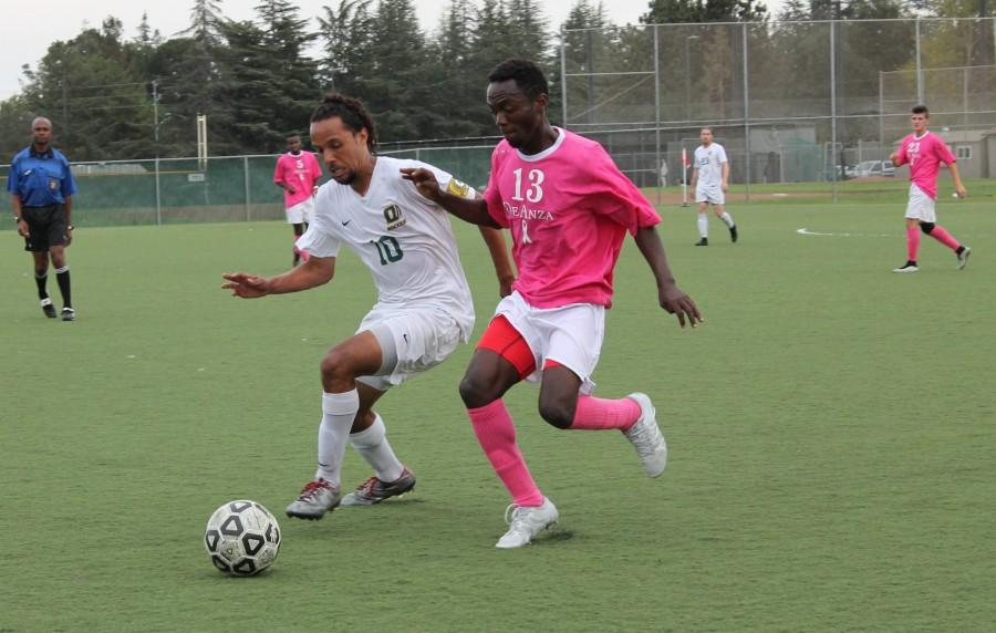 De Anza Forward Fiston Kizungu (13) battles with an Ohlone player in the Dons 6-0 win on Friday Oct 23.