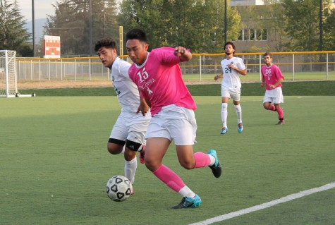Defender Brandon Hoang (15) blocks an Ohlone defender from a possession in the Dons match against Ohlone college on Friday Oct. 23.
