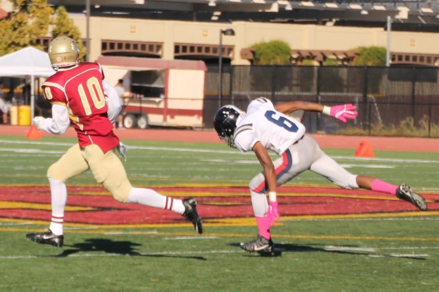 De Anza receiver Rodney McKenzie secures the catch from quarterback Ron Johnson that would result in a gain of 98 yards against Santa Rosa College on Saturday Oct. 31.