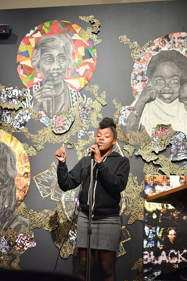 Lena Nelson, 18, music major, sings a self written song in the Euphrat Museum for First Thursday Open Mic on Thursday, Nov. 13.
