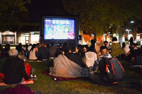 "Movie on the lawn: Students stay warm for an outdoor screening of ""Inside Out"""