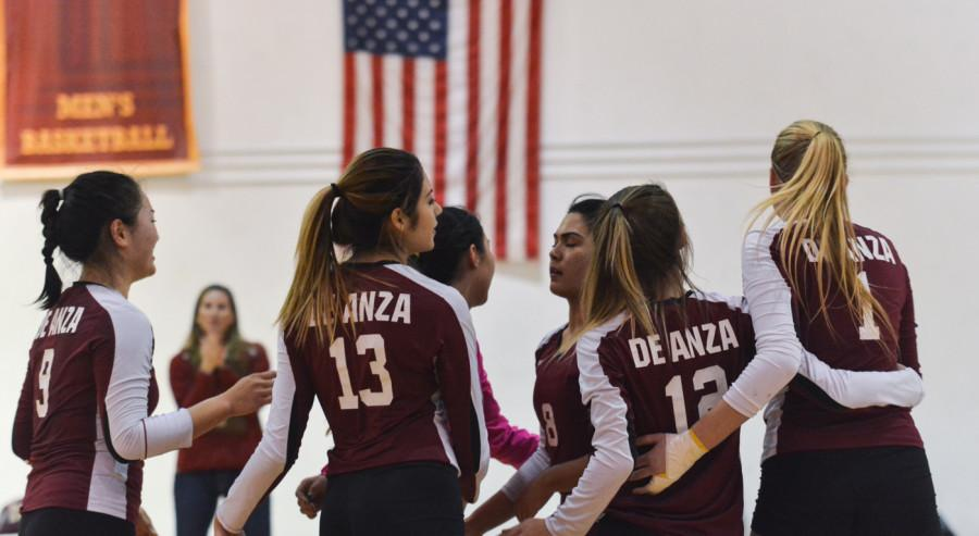 De Anza Right side hitter Griselda Romo (13) and teammates group together after scoring a point versus Foothill College on Wednesday Nov. 11.