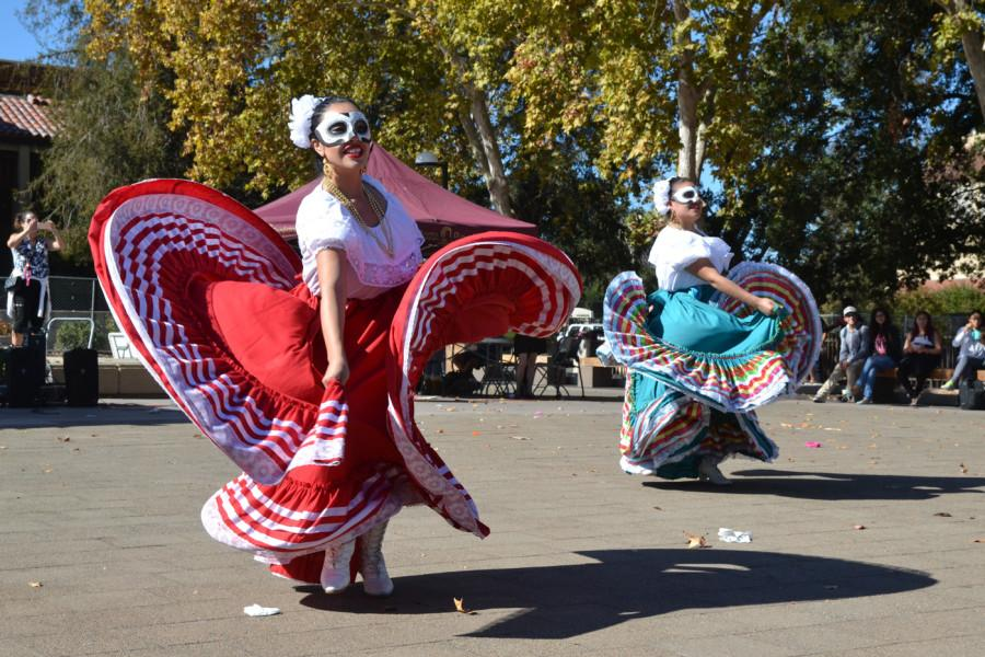 Andrea Yepez, 21, buseness administration major, and Sharon Marfil, 19. biology major, perform a Mexican folkloric dance during Dia de los Muertos celebration in the Main Quad on Thursday Oct. 29.