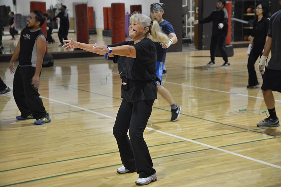 Instructor Nancy Evans leads her Cardio- Kickboxing class through an excercise routine.