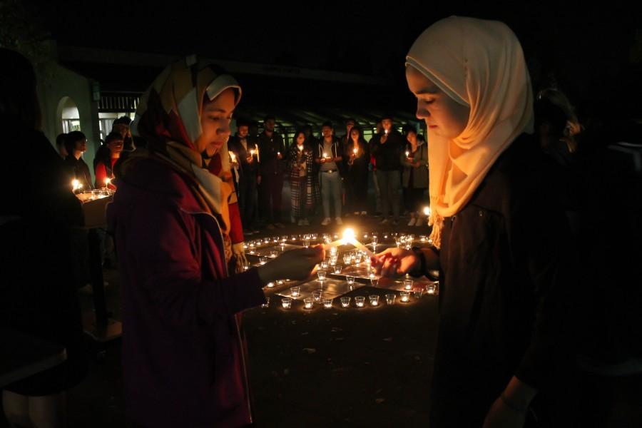 Mourning tragedies around the world: De Anza students host candlelight vigil