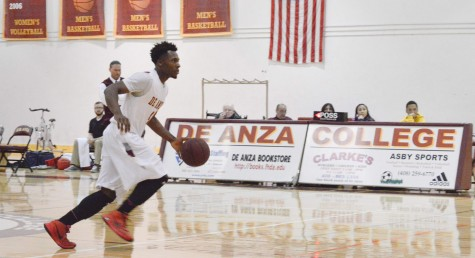Forward Ifeanyi Ekechukwu (4) moves down court in the Dons game against Gavilian College on Friday, Jan. 15.