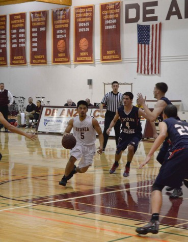 Guard Jeremy Ishimaru (5) drives to the net in the Dons 70-68 win over the Rams. Jeremy led the team in scoring with 20 points.