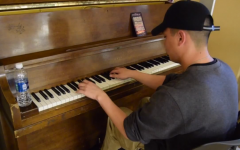 1 in 23,000: Alex plays the piano with passion