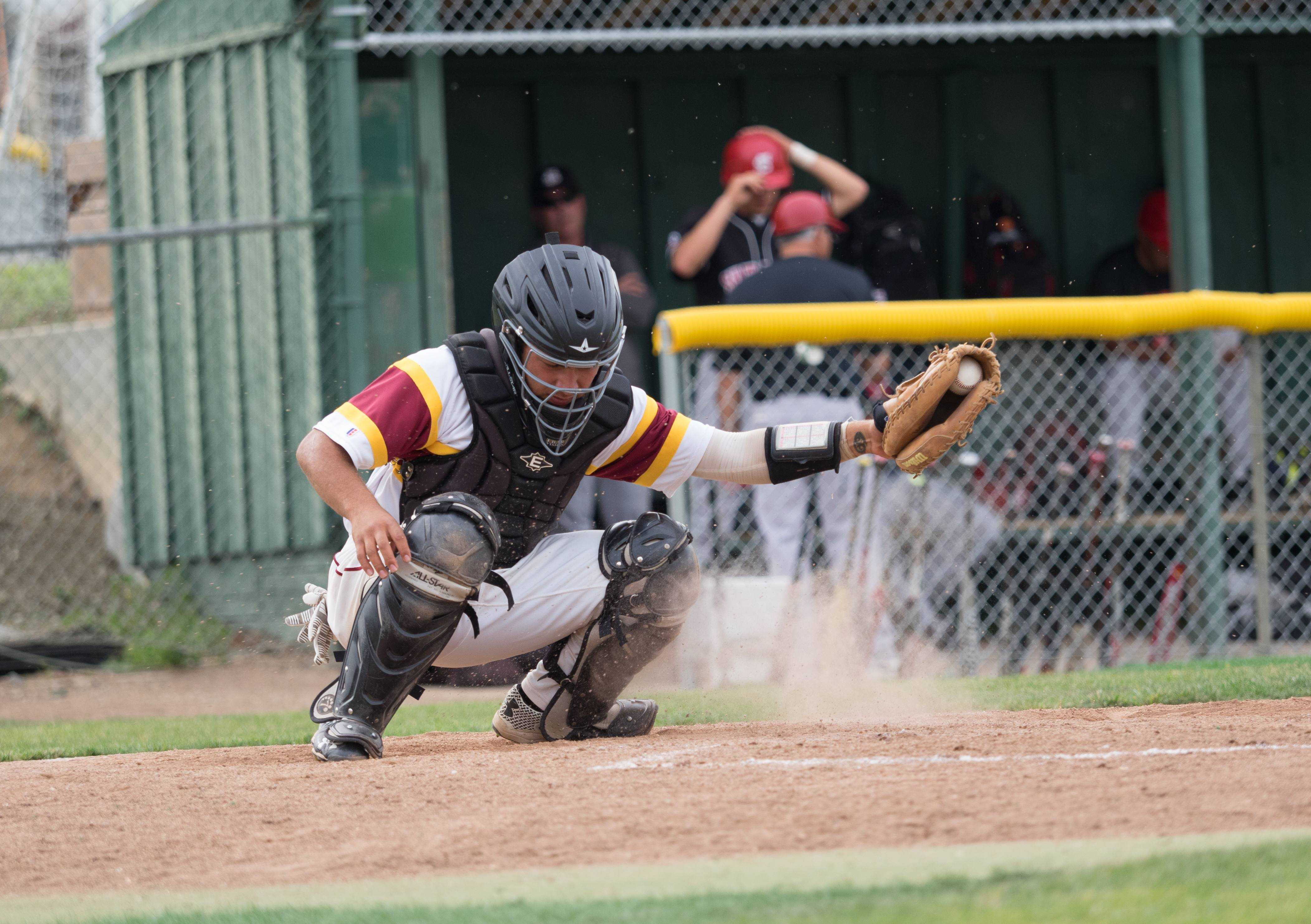 Catcher Rohith Mahanty scoops a bouncing pitch from the dirt in the De Anza College baseball game against San Francisco City College on Thursday, April 7.