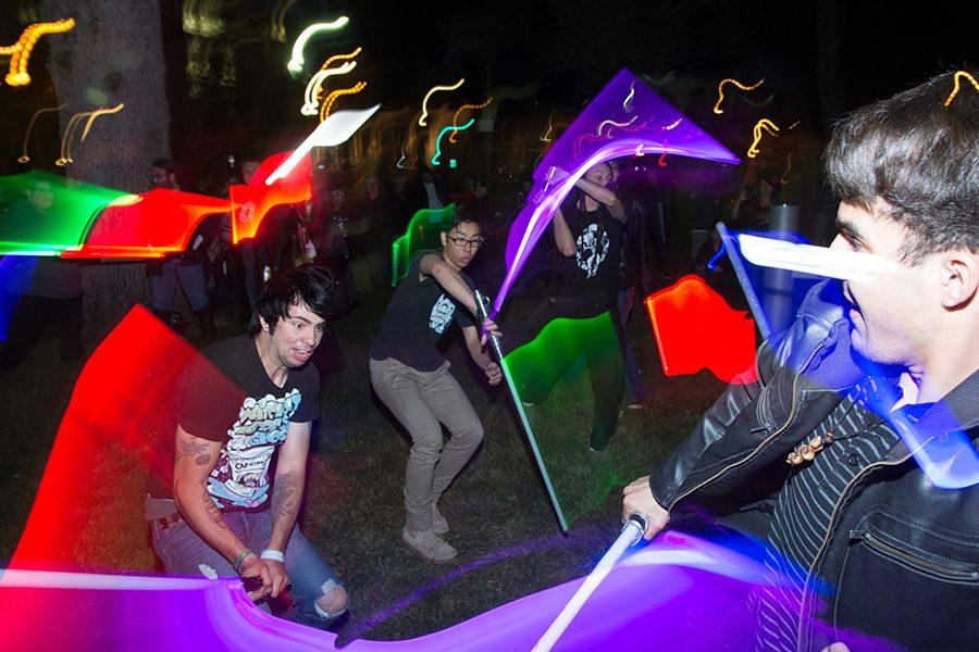 """Participants wielding Lightsaber battle clash in a """"Cats in Space"""" event in St. James Park, Downtown San Jose on April 30."""