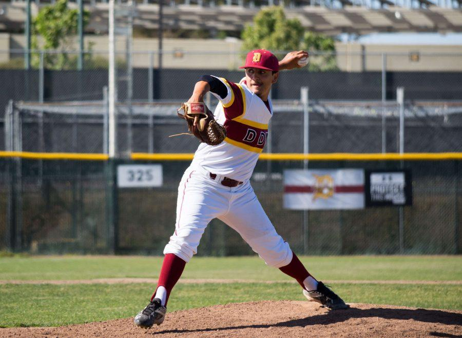 Left-hander Lorenzo Gomez (9) pushes off the mound as he prepares to throw a pitch during the Dons' match against the Vikings Thursday, April 28.