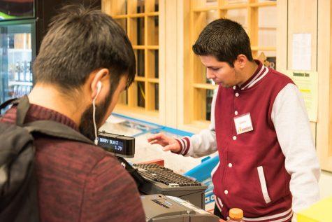 Gilberto Mercado, 20, law enforcement major helps a customer buy a drink from the De Anza convenience store.