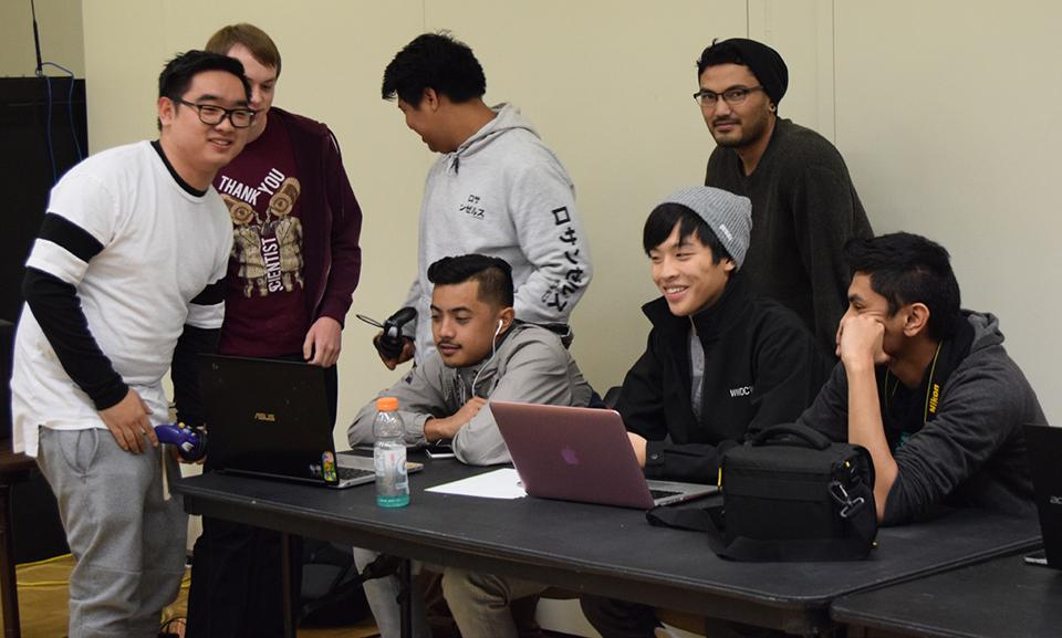The tournament officials register players, call out rounds and joke around with some of the competing students at De Anza's fireside lounge Nov. 30.