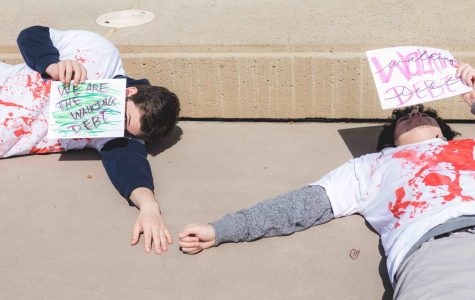 Students protest CSU tuition increases with 'Walking Debt' zombie lie-in