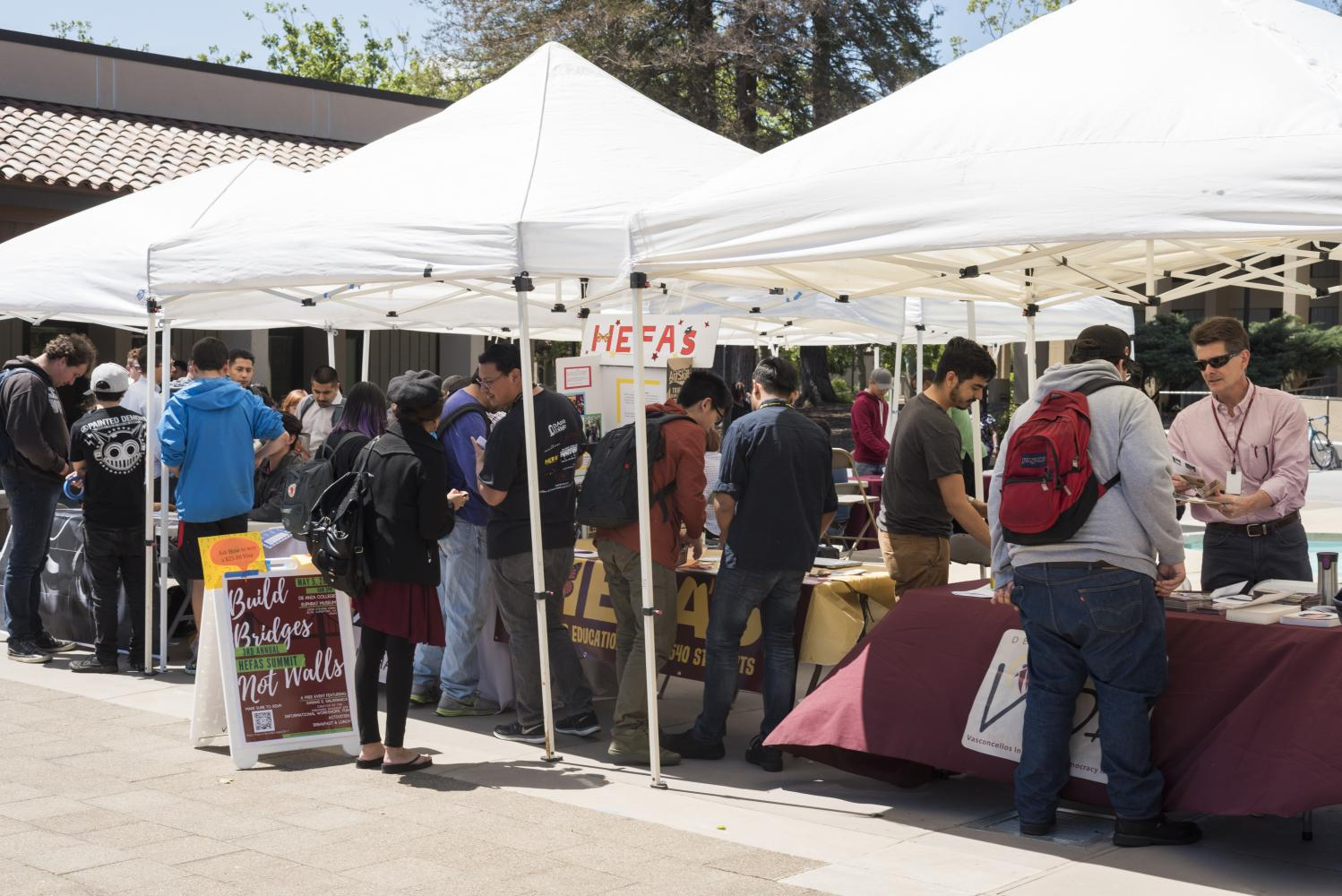 Students crowd around the Higher Education For AB 540 Students and Vasconcellos Institute for Democracy in Action booth to learn more about the organizations during the VIDA Project Fair on April 20